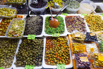 Various pickled olives in cans