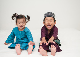 Malay / Asian / Muslim kids in traditional clothing