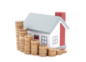 House with stack of coins. Clipping path included.