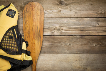 canoe paddle and life jacket