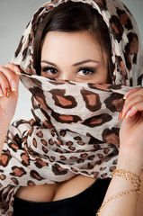 sexy woman covers her face with her handkerchief