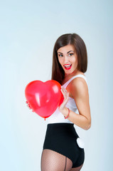 A beautiful woman with a balloon in the shape of a heart