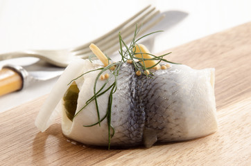 pickled herring with gherkin and onlion