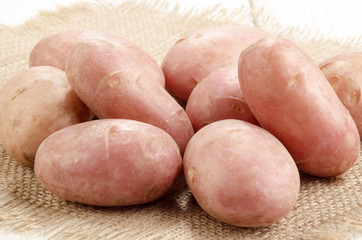 cleaned red potatoes on jute