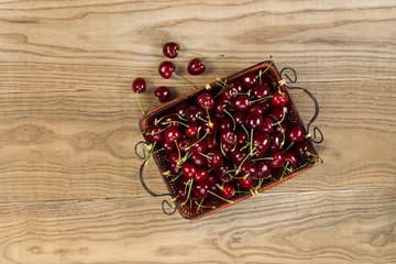 Fresh Black Cherries in basket place on Rustic Wood
