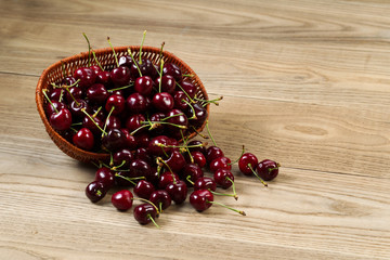 Fresh Black Cherries on Rustic Wood