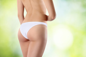 body of woman exposing bottom and back side, on green background