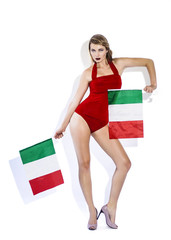 Sensual football supporter holding Italy flags and posing