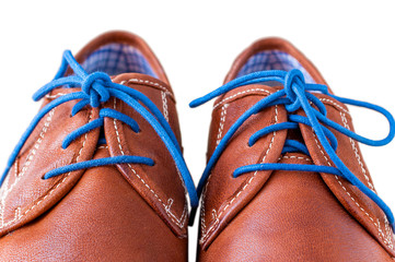 Detail of men's leather shoes with colorful laces