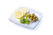 lemon, arugula and olives on a glass plate