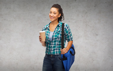 smiling student with bag and take away coffee cup