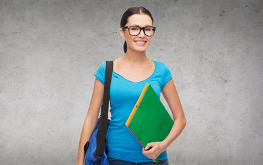 smiling student with bag and folders