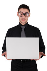 Surprised Young Man with Glasses Holding Laptop