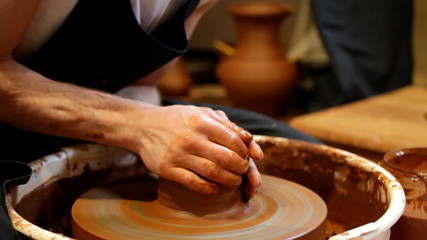 Potter works at a potter's wheel