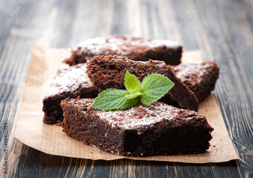 Staande foto Snoepjes Cake chocolate brownies on wooden background