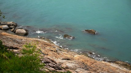 Rocky Shore and Blue Sea Waves. Thailand. Koh Samui.