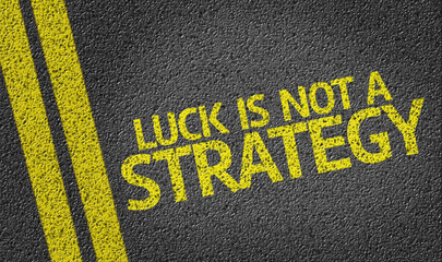 Luck Is Not a Strategy written on the road