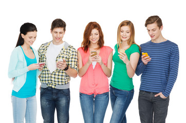 smiling students with smartphones