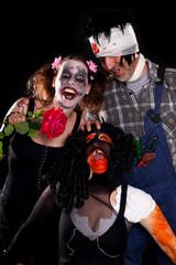 Hexe Clown und Zombie feiern Halloween