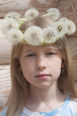 little girl in white dandelion crown