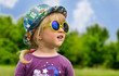 Adorable little girl in trendy sunglasses