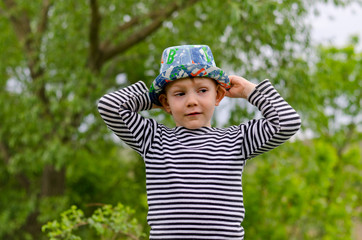 Jaunty macho little boy in a colorful trendy hat