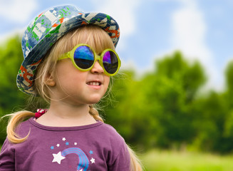 Cute pretty little girl in trendy summer fashion