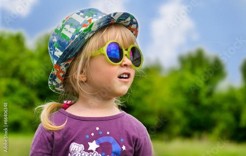 Adorable little girl in trendy sunglasses