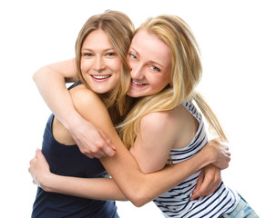 Two young women are hugging as a best friends