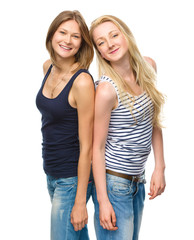 Two young happy women posing
