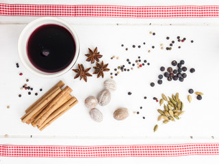 mulled wine and christmas spices with  red ribbon