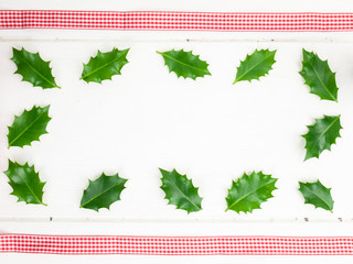 holly leaves and red ribbon