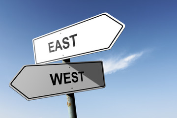 East and West directions.  Opposite traffic sign.
