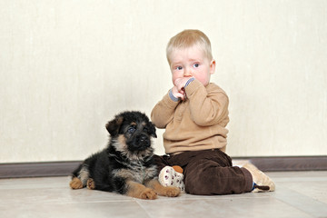portrait of a little boy with a puppy