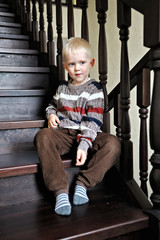 portrait of a little boy in a sweater at home