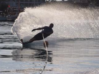 man waterskiing slalom on sea in Greece