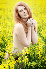 Beautiful naked redhead in a nature
