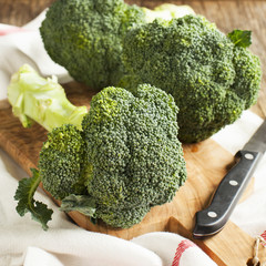 Fresh broccoli on wooden board