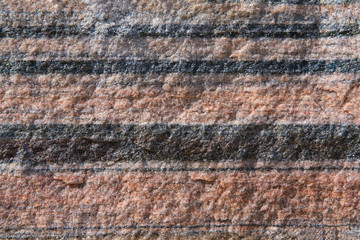 Red granite with gray stripes, closeup