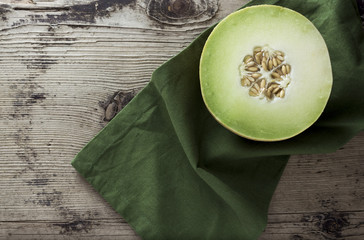 Melon on wooden background