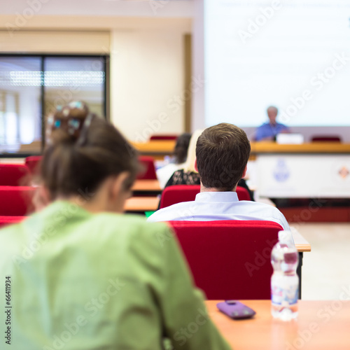 Students listening to the lecture.