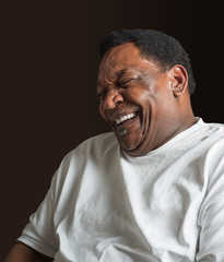 middle aged African American man laughing