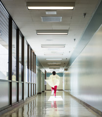 Health care working running down a corridor