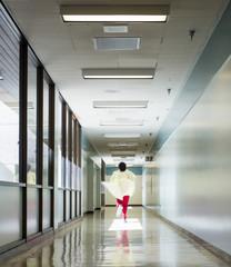 Health care working running down a corridor
