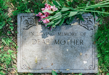 Flowers on Mothers Grave Marker