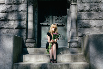 Grief:  Woman Sitting on Mausoleum Steps