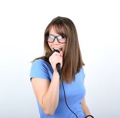 Portrait of a young female with microphone against white backgro