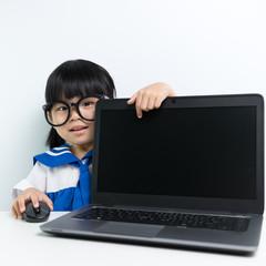 Baby girl using laptop