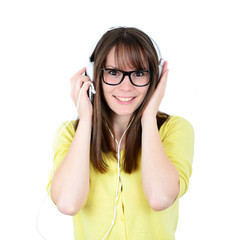 Woman dancing with earbuds / headphones listening to music on mp