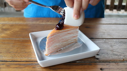 Baker make topping of blueberry crepe cake, stock footage
